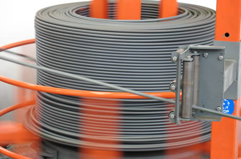 Coiled wire processing